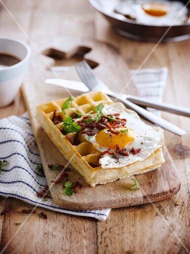 A Brussels waffle with fried egg and bacon