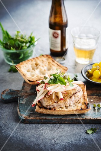Pork Burger with apples and pickles in beer