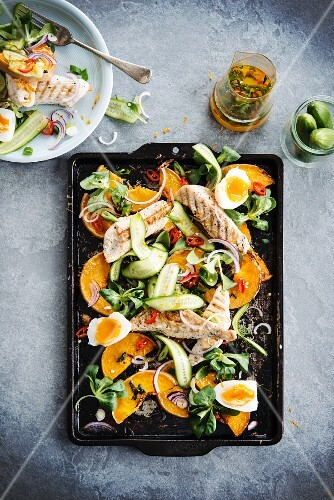 lamb's lettuce with pumpkin, turkey, cucumber and soft-boiled eggs