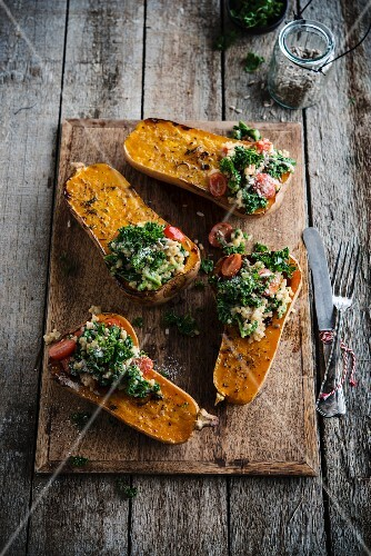 Baked Butternut Squash filled with kale, semolina and raisins