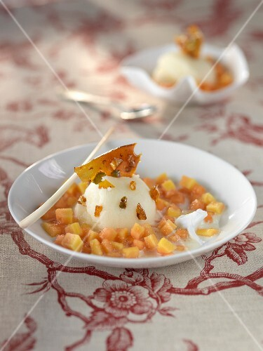 Cold spicy milk soup,diced papaya,pineapple and toffee ice cream with almonds and pistachios
