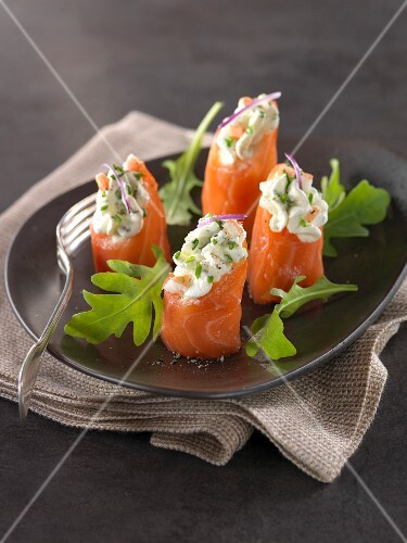 Smoked salmon rolls garnished with shrimp mousse,chives and horseradish