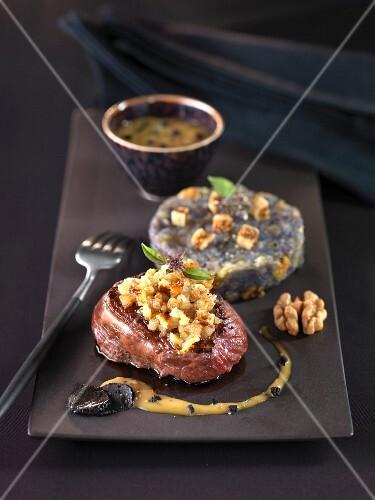 Stag steak with truffle gravy,tender Vitelotte potatoes and figs