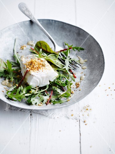 Steamed cod with crumble topping,rocket lettuce salad