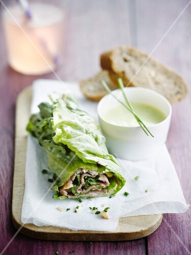 Roast beef and lettuce wrap with white dressing