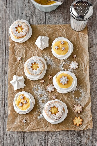 Lemon meringue tartlets in meringue nests