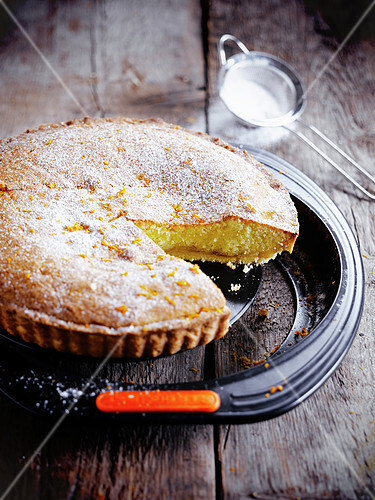 Orange cake with icing sugar