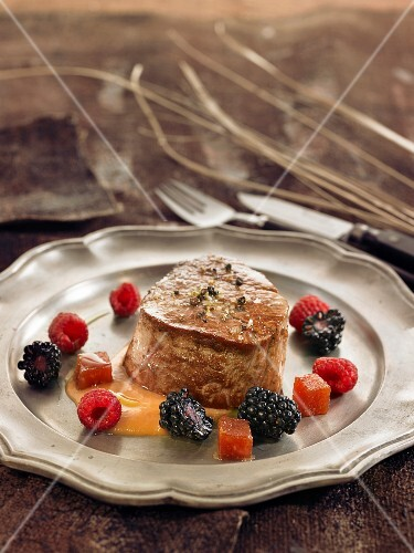 Tournedos with quince sauce and wild fruit