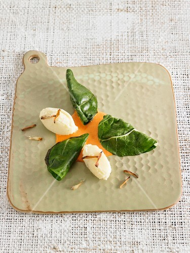 Mashed potato dumplings with chard leaves and Romesco sauce
