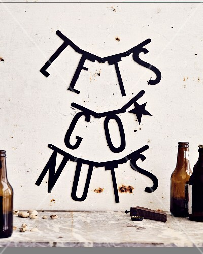 The words 'Let's Go Nuts' written on a wall