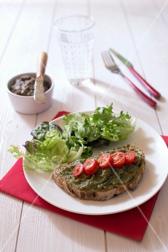 A slice of bread topped with courgette and seaweed spread