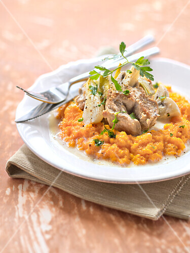 Veal stew on mashed carrots with cumin