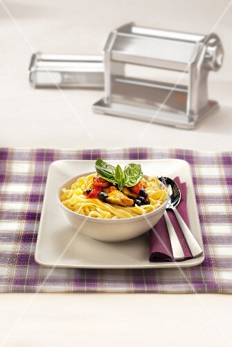 Tagliatelles with artichokes,olives,tomatoes and basil,pasta machine
