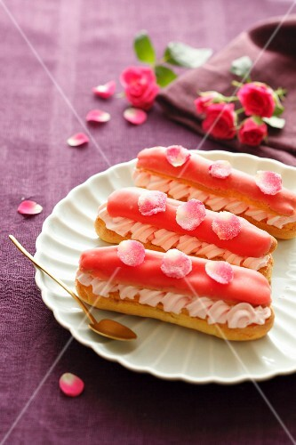 Eclairs decorated with rose petals