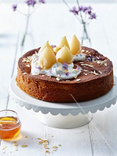 Honey and pear cake with almond cream and borage