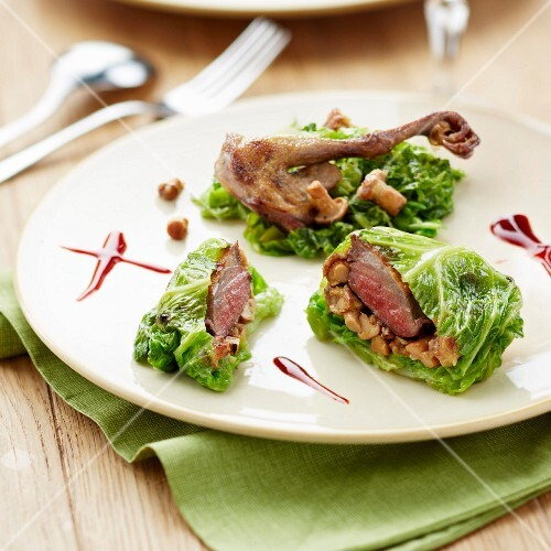 Cabbage leaves stuffed with pigeon and chanterelles