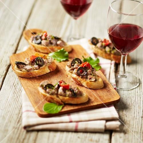 Wild boar,black olive and confit tomato tapas