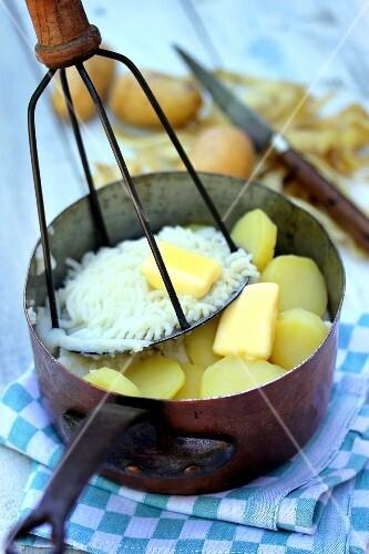 Mashing potatoes with a potato masher
