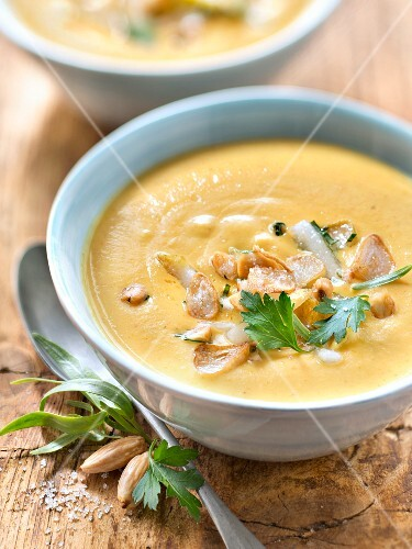 Thick parsnip and garam massala soup with pear and almond cream