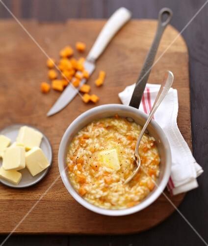 Preparing risotto with pumpkin