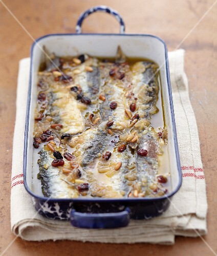 Sardines marinated in vinegar with pine nuts and raisins