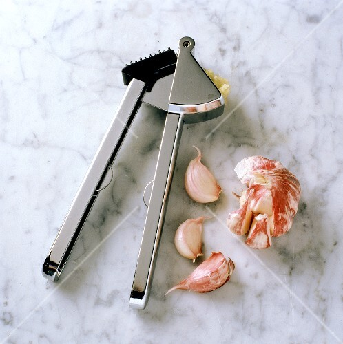 Garlic Press with Garlic on Marble/nSee Image #061085