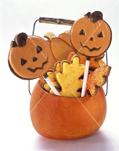 Festive Cookies and Lollipops in a Pumpkin Basket