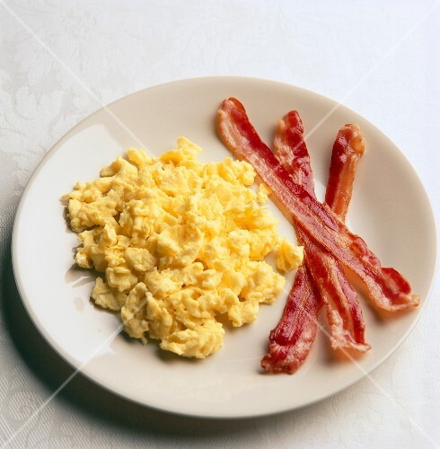 Scrambled Eggs and Bacon on a White Plate