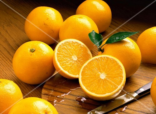 Whole Oranges with One Halved Orange/nSee Image #606481