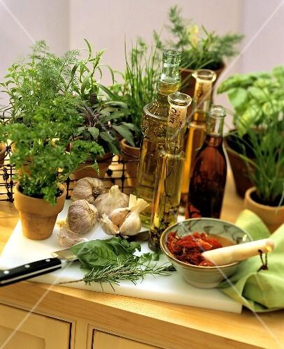 Still Life; Herbs Vinegar Oil and Sun Dried Tomatoes