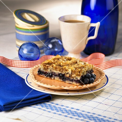 A Piece of Blueberry Coffee Cake with Coffee