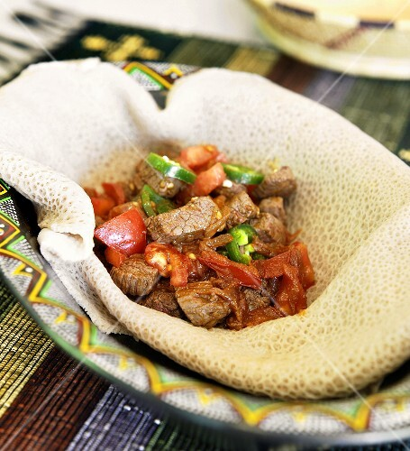 Beef and Vegetables on Injera in a Bowl