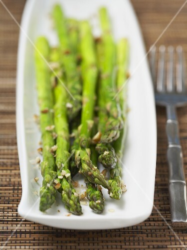 Dish of Cooked Asparagus with Crushed Walnuts