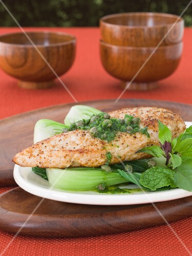 Spicy Chicken Breast Topped with Mint Caper Sauce on a Bed of Baby Bok Choy