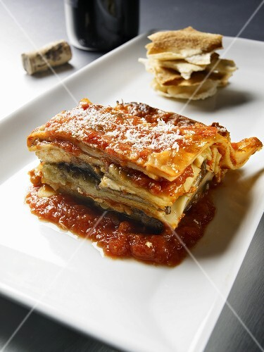 Piece of Vegetable Lasagna Served with Toasted Flat Bread