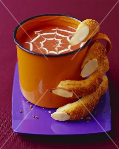 Bread Stick Fingers Grasping Mug of Pumpkin Soup