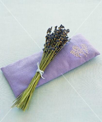 Lavender flowers on a lavender eye pillow