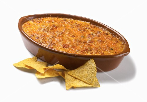 Baked Nacho Dip with Corn Chips on a White Background