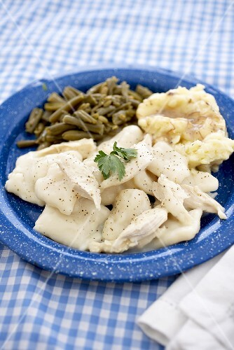 Chicken and Dumplings Over Mashed Potatoes with Beans on a Blue Plate