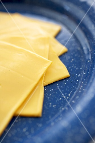 Slices of Yellow American Cheese on a Blue Plate