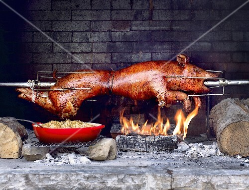 Whole Roasted Pig on Spit with White Beans