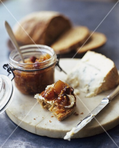 Piece of Bread with Cheese and Chutney on Board