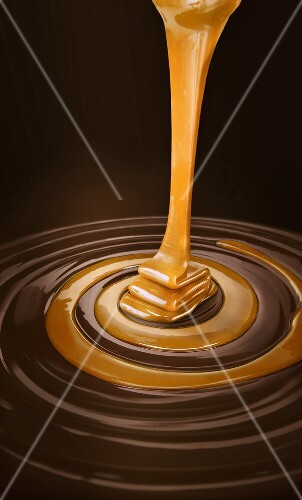 Caramel sauce pouring into swirled chocolate