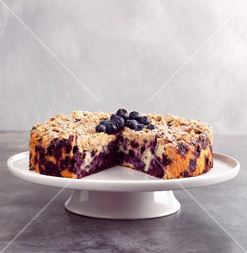 Blueberry Buckle with Slice Removed on Cake Plate