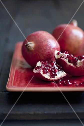 Pomegranates, whole and cut open