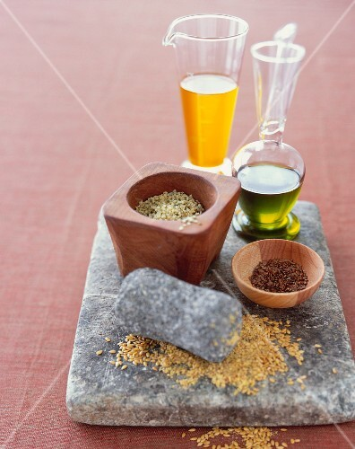 Flax and Hemp Seeds on Stone with Oils