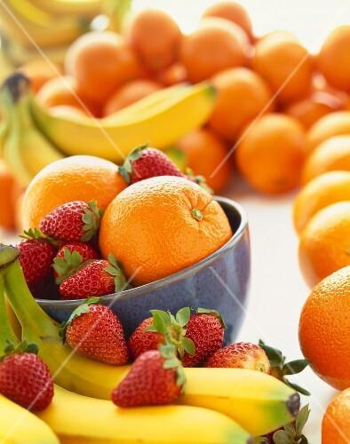 Colorful Fresh Fruit; Bananas, Strawberries and Oranges