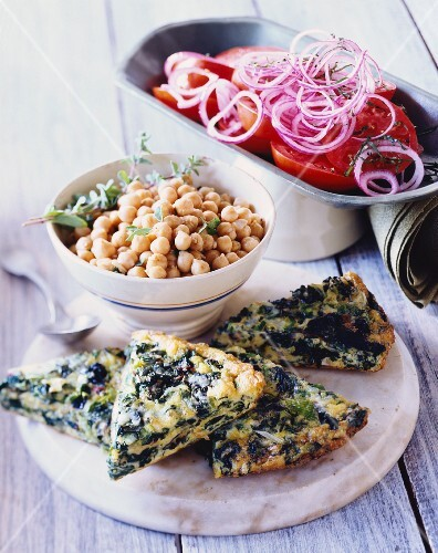Spinach frittata, chickpeas and tomato and onion salad