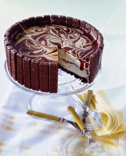 Marble Cheesecake with Wafer Cookie Crust; Slice Removed; On a Pedestal Dish