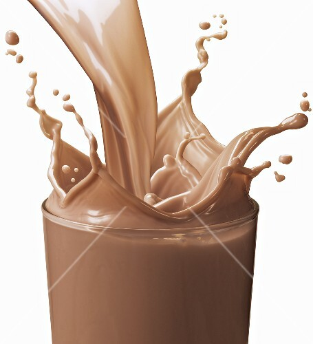 Pouring Chocolate Milk into a Glass; Splashing